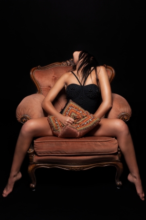 Seductive girl on a throne of pleasure Stock Photo