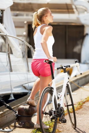 respite: Sportive girl having respite during bicycle ride