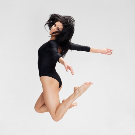 Woman in black outfit flying away photo
