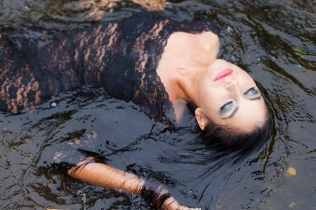 Luxury girl relaxing in floating water