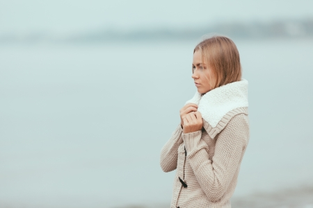 Attractive lonely and sad girl on the beach Stock Photo - 24138944