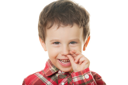 nose picking: Cute boy picking nose on isolated white