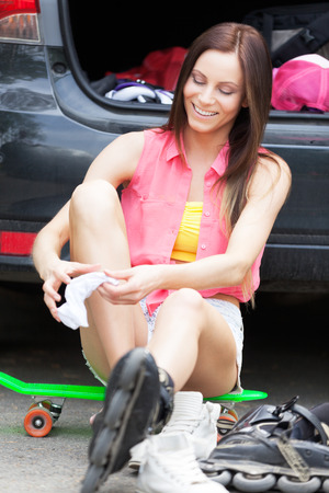 Roller girl preparing for a ride photo