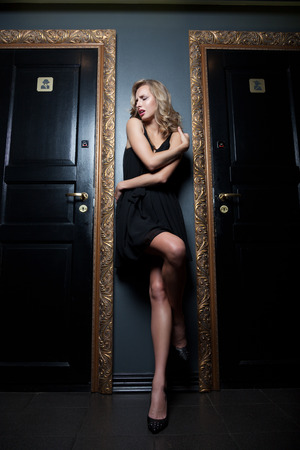 Woman having problems getting into toilet in the nightclub photo