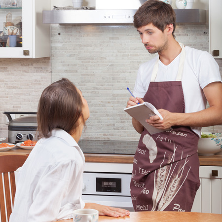 Woman ordering food at home  Stock Photo