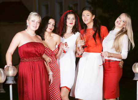 farewell party: Hen party: bridesmaids in red and white Stock Photo