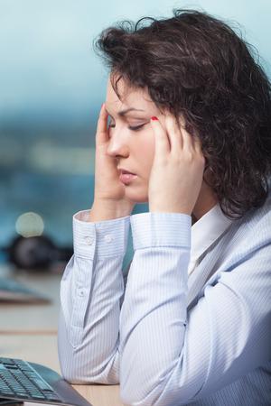 head ache: Woman having head ache at work