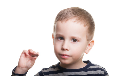 hand holding pills: Boy on isolated white asks whenever you took your medicine today