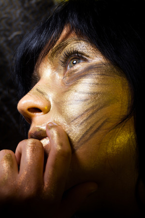Creative make-up technique: golden paint photo
