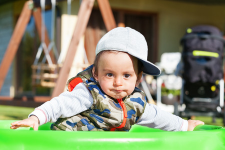 arabic boy: Surprised arabic boy playing outdoors
