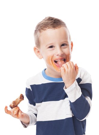 Adorable kid eating bbq ribs on isolated white