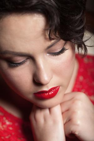 Close-up portrait of a red retro make-up photo