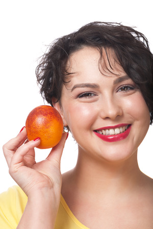 Portrait of a smiling woman holding red orange photo