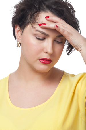 Woman having headache on isolated white photo