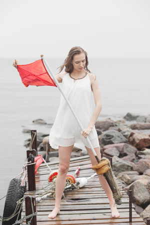 desperate: Desperate woman with red flag Stock Photo