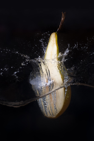 Pear dropped into the water