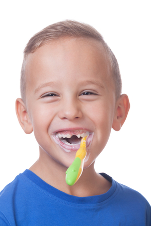 Portrait of a smiling kid with a toothbrush