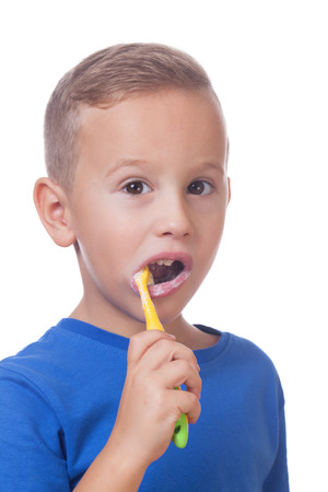 Charming kid with toothbrush on isolated white Stock Photo