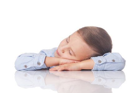 day dream: Relaxed and positive boy having day dream on isolated white