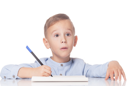 Amazed and thoughtful handsome boy with pen on isolated white Stock Photo