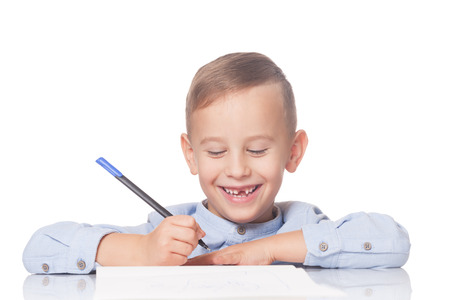 Happy kid with a pen on isolated white