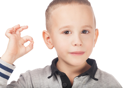 Boy showing that everything is OK Stock Photo