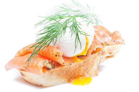 Homemade sandwich with salmon, poached egg and wholegrain bread on isolated white Stock Photo