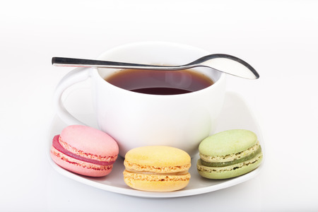 Multicultural minimalism: English tea and French macaroons Stock Photo