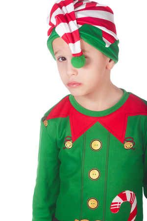 Adorable sad little elf on isolated white