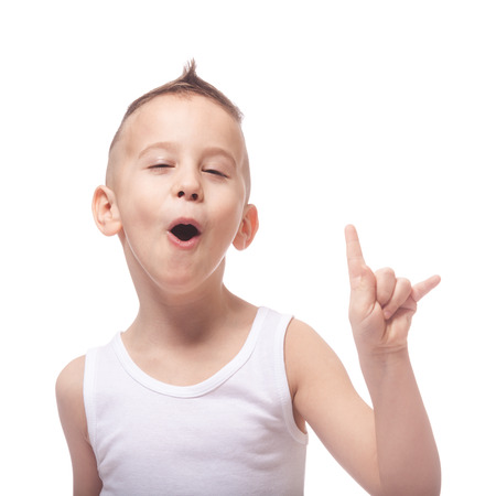 Funny adorable rocking kid in a white shirt on isolated white