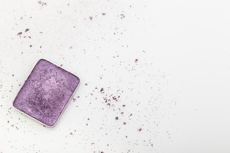 Purple make-up palette and crumbs