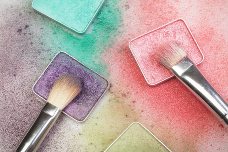 Different make-up palettes and brushes on white Stock Photo