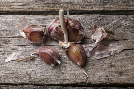 Garlic on the vintage wooden table