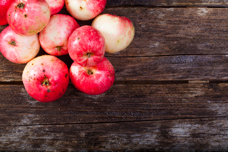 Group of red ripe apples on the vintage wooden table