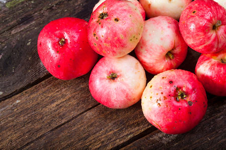 Bunch of red ripe apples on the vintage wooden table