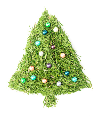 Christmas tree made of needles and decorated with beads on isolated white