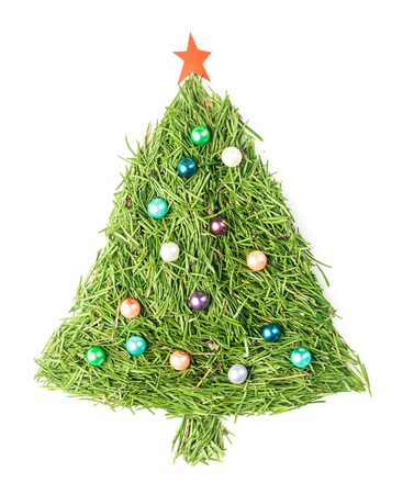 Christmas tree made of spruce needles decorated with beads and star on isolated white Stock Photo