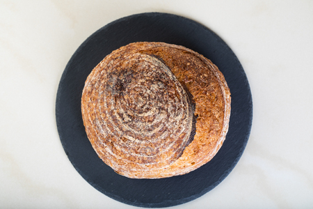 Wholewheat bread on black round plate