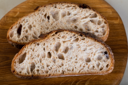 Wholewheat bread on wooden cutting board Stock Photo