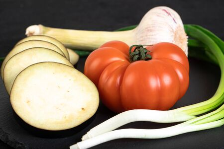 Assorted vegetables ob black stone plate Stock Photo - 132741010