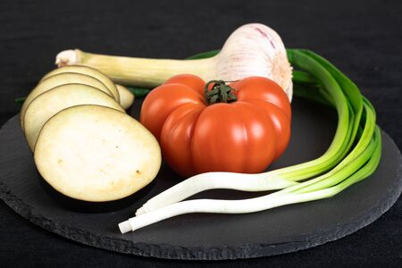 Assorted vegetables ob black stone plate Stock Photo - 132740760