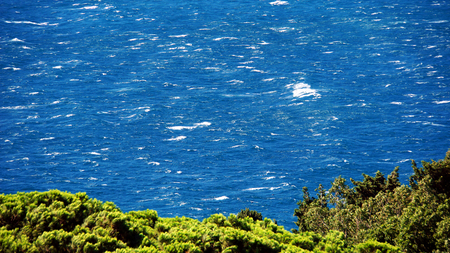 presence: live blue waves on the black sea in the distance Stock Photo