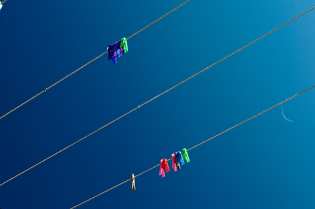 pegs on strings against the sky like notes Stock Photo