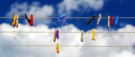 pegs on strings against the sky 3