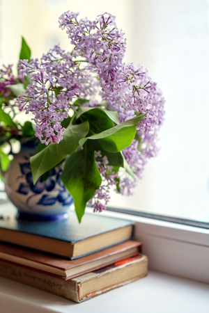 vase with lilac at Kona-scattered light on old books