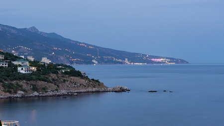 the view from fores in the Eastern part of the coastline in the night lights Foto de archivo