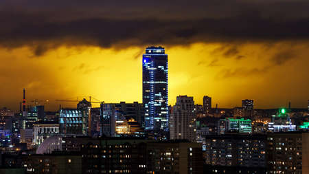 Vysotsky building in Yekaterinburg on the background of storm clouds at night 2