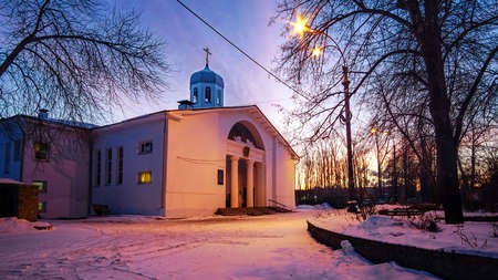 Church of the assumption of the blessed virgin Mary on a background of trees at dawn