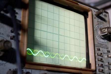 the old Soviet oscillograph with diagramas on the screen shot close up Stock Photo