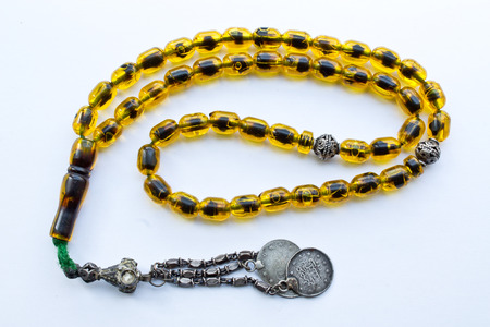ball and chain: beads of amber Stock Photo